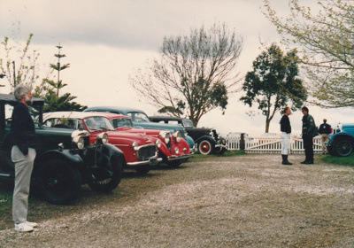 A line up of vintage cars parked at the entrace to Howick Historical Village on a Live Day.; Ashby, Muriel; P2021.108.25
