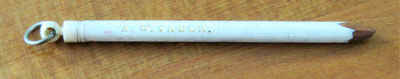 Thin pencil, with an ivory cap which has a knob on...