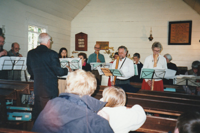 A recorder group playing in the Howick Methodist Church.; La Roche, Alan; P2020.41.01