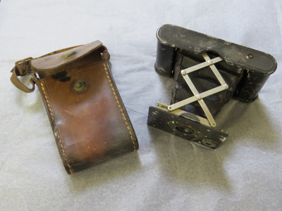 Camera in leather case belonging to H.S Morrow. Ca...