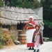 A lady and girl in costume outside the Sod Cottage, Howick Historical Village on a Live Day.; La Roche, Alan; 2003; P2020.43.38