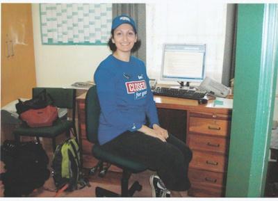 A BNZ worker at a desk in Howick Historical Village on BNZ staff volunteer day.; 4 September 2013; P2021.160.01
