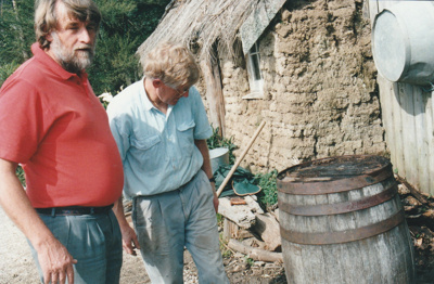 Barry Southern and Alan la Roche working on the trench around the Sod Cottage, Howick Historical Village.; March 1977; P2020.48.04