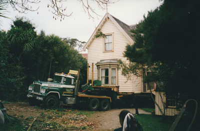 A Johnson's Heavy truck and trailer moving Puhinui to its new site in the Howick Historical Village.; Smith, Malcolm; May 2002; P2020.06.02