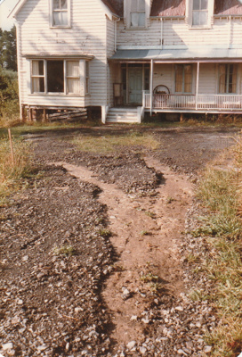 The access road to Puhinui, McLaughlin's Homestead at Howick Historical Village flooded after heavy rain, February 1985; Alan La Roche; February 1985; P2020.08.04