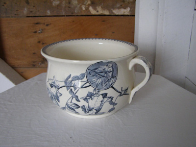 Ceramic chamber pot with navy birds and floral des...