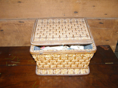 Straw sewing box with padded blue silk lining.
