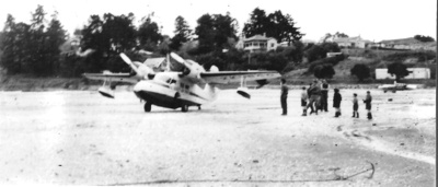 Captain Ferd Ladd landed his amphibian plane at Ho...