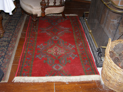 Turkish rug with a white tassel fringe along the e...