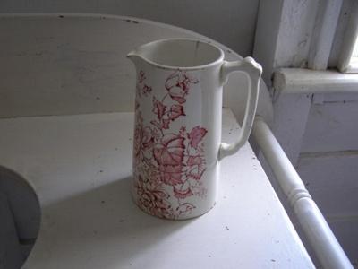 Large ceramic Jug with dark red flower design.