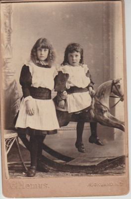 Two unnamed girls. one sitting on a rocking horse.; Hemus, C, Auckland; 2018.363.10