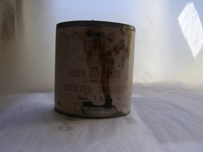 John Cotton's Finest Smoking Tobacco tin contain...
