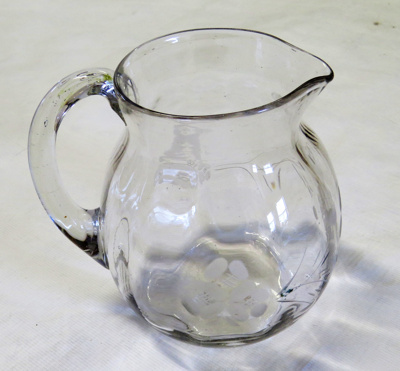 Water Jug with a handle. The glass is etched with ...