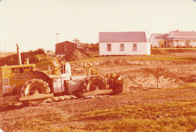 A bulldozer digging out the pond in the Howick Historical Village.; La Roche, Alan; Spetember 1982; P2020.21.37