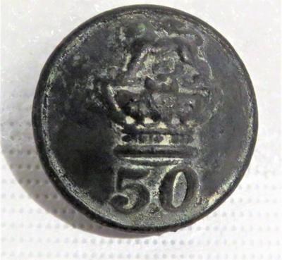 Brass button worn by a soldier of the 50th Regimen...