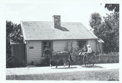 A horse and cart outside Briody-McDaniel cottage on Church Street in Howick Historical Village.; La Roche, Alan; 27 February 1988; P2021.180.03
