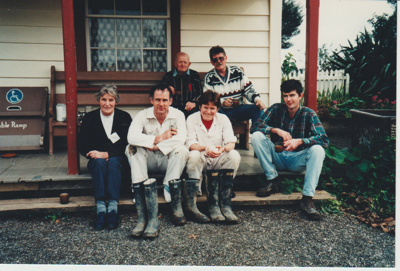 A working bee volunteer group on the steps of Brindle Cottage; 1996; 2019.129.24