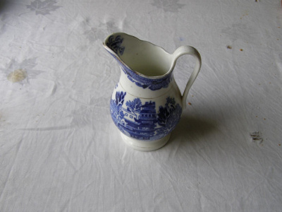 Ceramic milk jug with blue willow design and gold ...