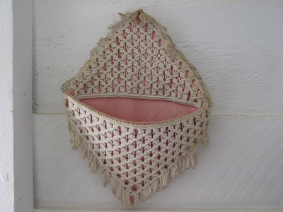 Pink wall hanging pocket with white crochet. Used ...