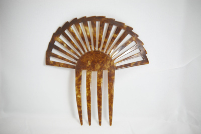 Women's tortoiseshell decorative hair comb.