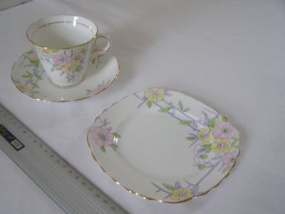 Ceramic teacup and saucer, matching bread plate, p...