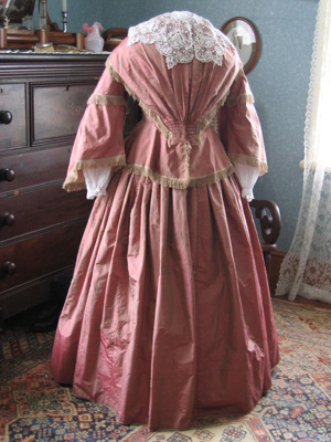 Handsewn late 1850s two piece pink shot silk bodic...