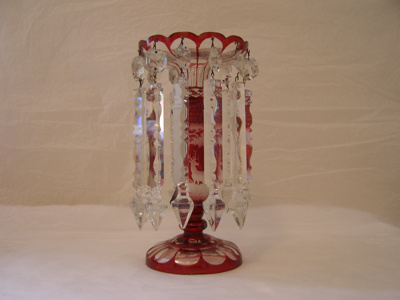 Partly painted red glass candlestick with clear im...