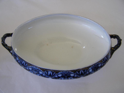 ceramic dish with blue designs, missing lid.
