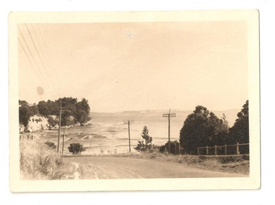 """Photograph: """"Looking down on beach from half way up the road to estate road""""; Mr Gregory; C. 1950; 00032"""