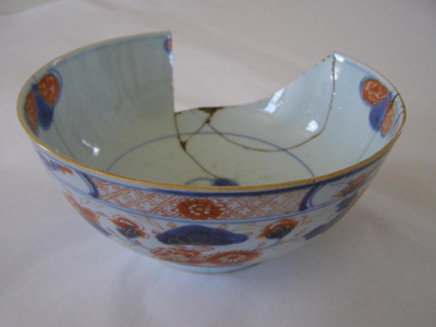 blue ceramic bowl, broken and some cracks.