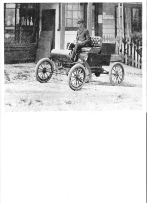Early motor vehicle serving as mail car outside Wa...