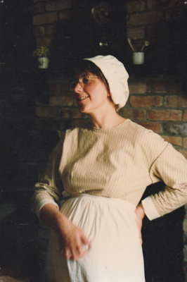 """Barbara Doughty, from the Education Dept. in costume acting as a pregnant housewife in """"A woman's lot"""".; P2021.105.05"""