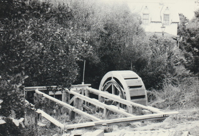 Beginning construction of Bycroft's waterwheel in Howick Historical Village.; La Roche, Alan; April 1991; P2021.86.15