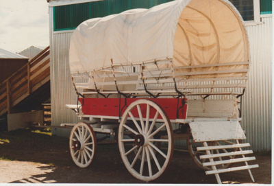 A covered wagon in the Clydesdale Museum.; 30/08/1981; 2017.553.35