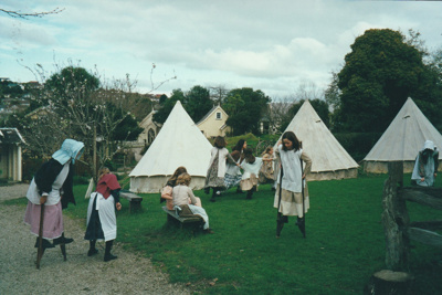 A girl on stilts in Howick Historical Village.; La Roche, Alan; 20 September 1992; P2021.125.10