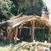 Hemi Pepene's whare (cottage) at the Howick Historical Village, showing the raupo roof partly covered with iron.; La Roche, Alan; December 2000; 2020.96.05