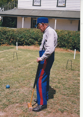 Alan la Roche (in Fencible uniform) playing croquet on the green in Howick Historical Village on a Live Day.; P2021.118.07