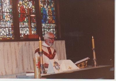 Reverend Kidd at the altar.; 2018.375.03