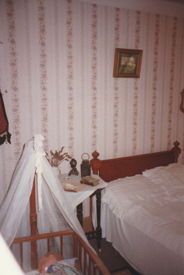 The bedroom of Briody-McDaniels Cottage at Howick Historical Village.  ; 1997; P2020.102.07
