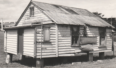 Maher-Gallagher Cottage, formerly Carter Cottage, in position at the Howick Historical Village.; Eastern Courier; 1978; P2020.91.24