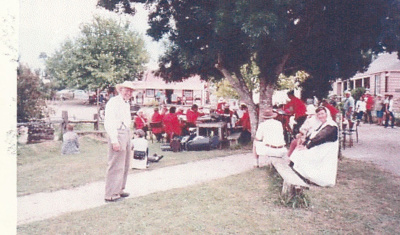 Alan la Roche and Marion Cartwright behind the Smiths' Locksmiths Manukau City Brass Band performing at the Howick Historical Village; Chipperfield, Fred; c2003; P2021.112.01