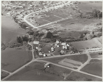 Aerial view of the Howick Historical Village.; Homer, Lloyd New Zealand Geological Survey; 1/08/1982; 2019.104.02