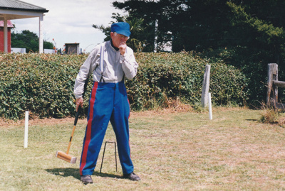 Alan la Roche (in Fencible uniform) playing croquet on the green in Howick Historical Village on a Live Day.; P2021.118.08