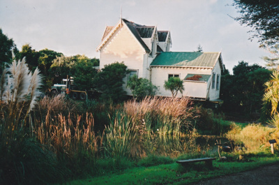 Side view of Puhinui being prepared for removal to its new site in the Howick Historical Village.; Alan La Roche; May 2002; P2020.11.36