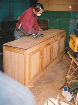 David Wardlaw working on a kitchen cabinet in Puhinui. ; Alan La Roche; 2003; P2020.14.30