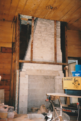The fireplace and chimney in Puhinui kitchen under construction by Gary McCarthy.; Alan La Roche; September 2003; P2020.14.20