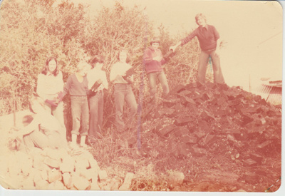 Seven members of the Girls' Brigade stacking paving stones.; 27/05/1979; 2019.100.08