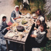 Debbie Benson and others, all in costume having a meal outside the sod cottage in the Howick Historical Village.; La Roche, Alan; P2020.50.20