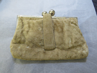 Clutch purse made from brown/grey fur with a silve...