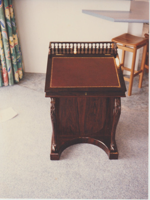 A davenport desk brought to New Zealand by James White.; 2018.430.21